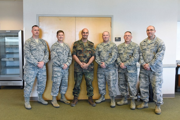 Lt. Col. Teddy Wundenberg, third from left,a maintenance officer for Helicopter Wing 64 of the German Air Force, poses for a photo with the 167th Airlift Wing's Inspector General staff during the 167th AW's deployment training exercise in Alpena, Mich., last June. Lt. Col. James Freid-Studlo, the 167th AW inspector general, second from left,  hosted Wundenberg for about two weeks as part of the Military Reserve Exchange Program.