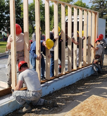 Members of Montana Air National Guard's 219th RED HORSE Squadron work with high school students from C.M. Russell and Great Falls to build a workshop for Grace Veterans Home. The workshop will be used to teach Veterans skills that will help them transition to the workforce. (Courtesy photo)