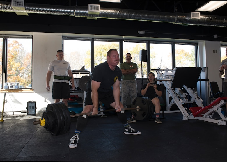 Tech Sgt. Todd Scruton, a crew chief with the 157th Maintenance Group, lifts 425 pounds during the first weight lifting competition held at Pease Air National Guard Base, N.H. Nov. 4, 2018. The competition was part of the Aircraft Maintenance Squadron's commander's challenge and included squat, deadlift, bench and run components. (Photo by Airman 1st Class Victoria Nelson, 157th ARW Public Affairs)