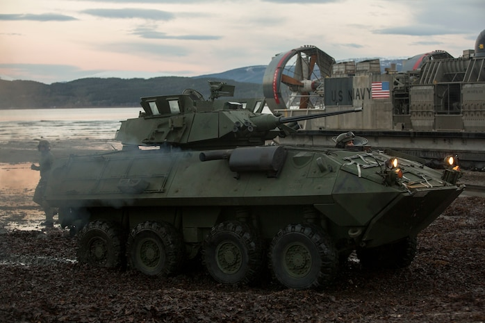 A light armored vehicle drives on Alvund Beach, Norway after disembarking a landing craft air cushion during an amphibious landing in support of Trident Juncture 18, Oct. 30, 2018.