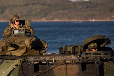 Marines prepare equipment on a light armored vehicle at Alvund Beach, Norway during an amphibious landing in support of Trident Juncture 18, Oct. 30, 2018.