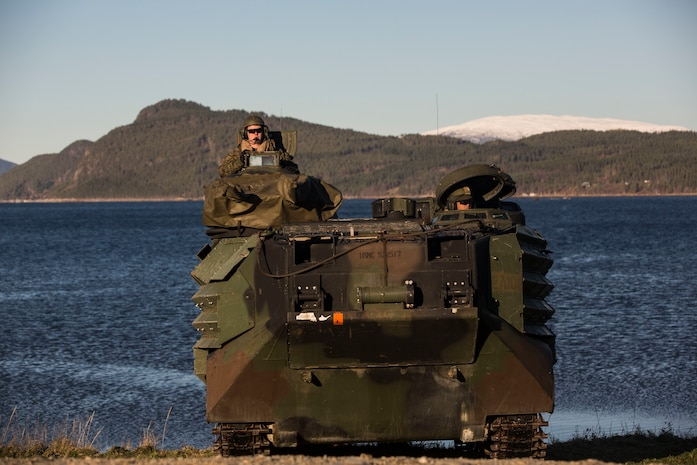 Amphibious assault vehicles come ashore during an amphibious landing in support of Trident Juncture 18 on Alvund Beach, Norway, Oct. 30, 2018.