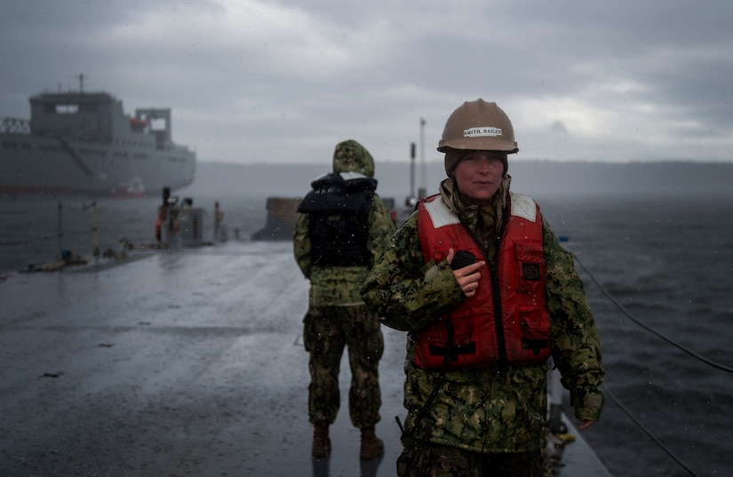Boatswain's mate seaman apprentice assigned to Amphibious Construction Battalion 1 prepares U.S. Navy Improved Navy Lighterage System causeway ferry for on-loading during Joint Logistics Over the Shore 2016, Naval Magazine Indian Island, Washington, June 13, 2016 (U.S. Air Force/Kenneth W. Norman)