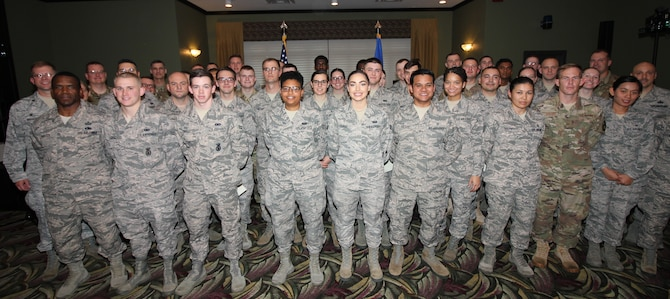 Team Wright-Patt's newest enlisted promotees pose for a group photo following a promotion ceremony at the Wright-Patt Club, Wright-Patterson Air Force Base, Ohio, Oct. 31, 2018. (U.S. Air Force Photo/Thomas Lewis) 181031-F-ZZ000-1009