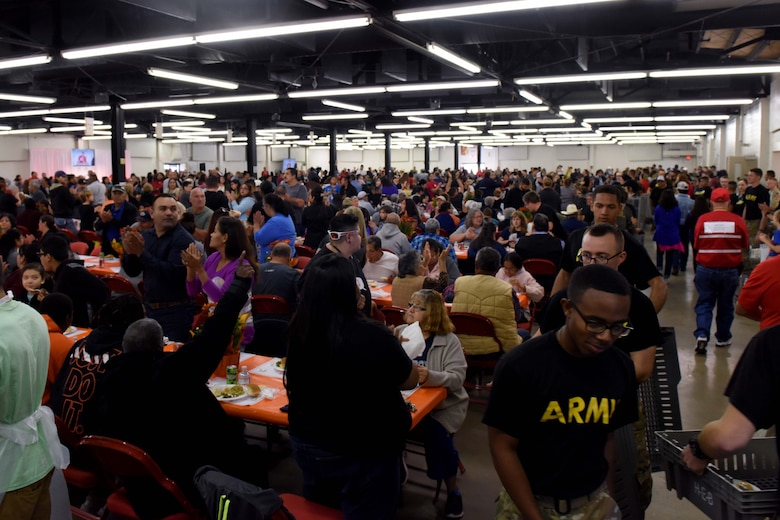 Soldiers from Goodfellow Air Force Base fill trays with food during the Feast of Sharing at the Wells Fargo Pavilion in San Angelo, Texas, Nov. 4, 2018. Goodfellow members volunteered their time for the local event. (U.S. Air Force photo by Senior Airman Randall Moose/Released)