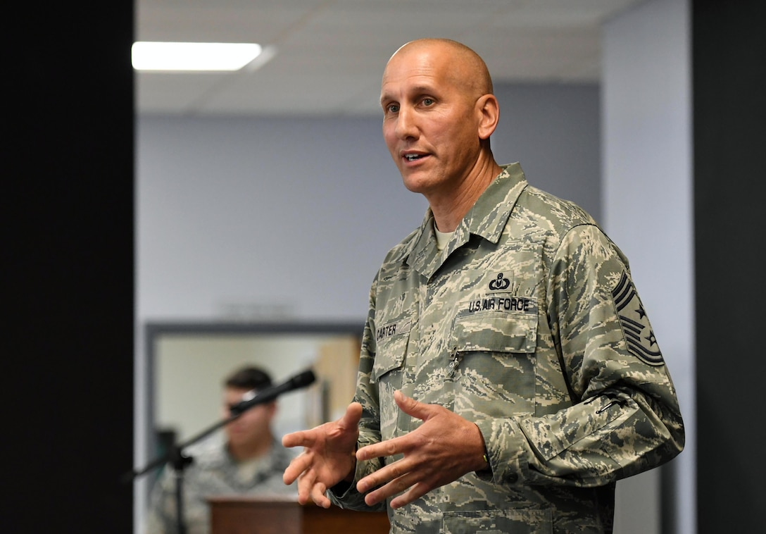 U.S. Air Force Chief Master Sgt. Kenneth Carter, 81st Training Wing command chief, delivers remarks during his retirement farewell reception at Keesler Air Force Base, Mississippi, Nov. 2, 2018. Carter retired with more than 29 years of military service. (U.S. Air Force photo by Kemberly Groue)