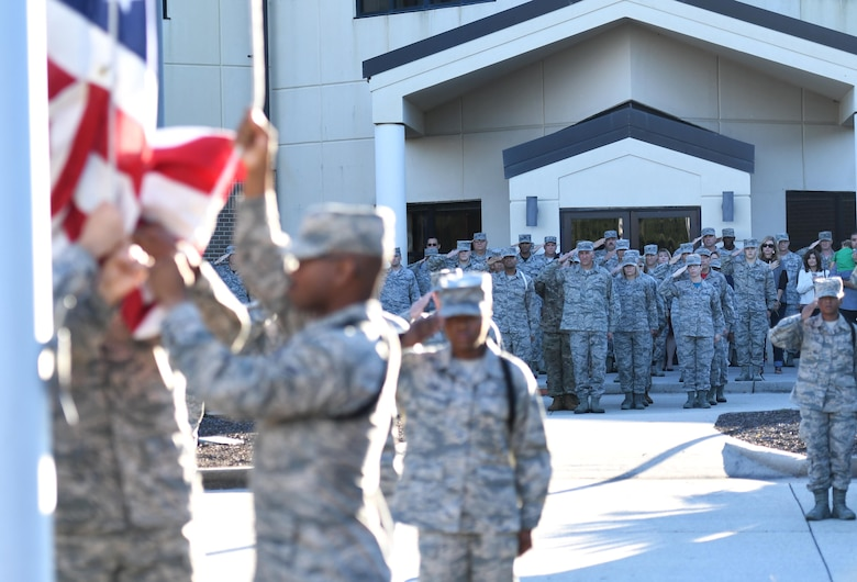 U.S. Air Force Chief Master Sgt. Kenneth Carter, 81st Training Wing command chief, and Keesler Airmen render a salute during a retreat ceremony at Keesler Air Force Base, Mississippi, Nov. 2, 2018. The ceremony was held in honor of Carter who retired with more than 29 years of military service. (U.S. Air Force photo by Kemberly Groue)