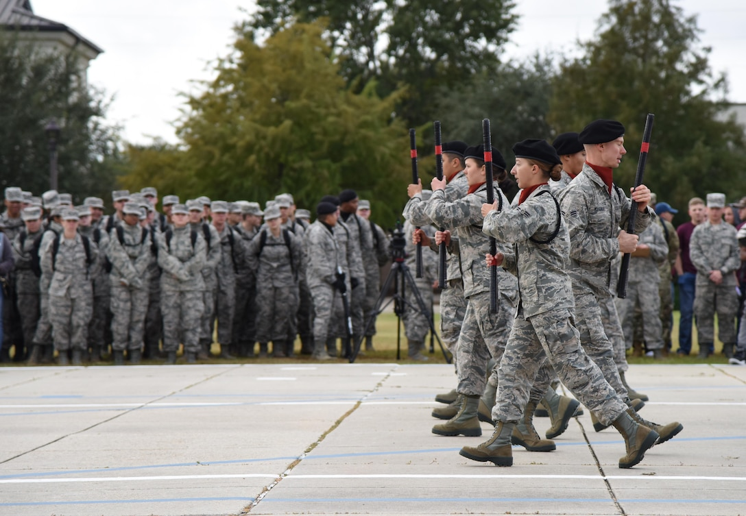 "Members of the 335th Training Squadron freestyle drill team perform during the 81st Training Group drill down on the Levitow Training Support Facility drill pad at Keesler Air Force Base, Mississippi, Nov. 2, 2018. The 335th TRS ""Bulls"" took first place overall this quarter and for the year. (U.S. Air Force photo by Kemberly Groue)"