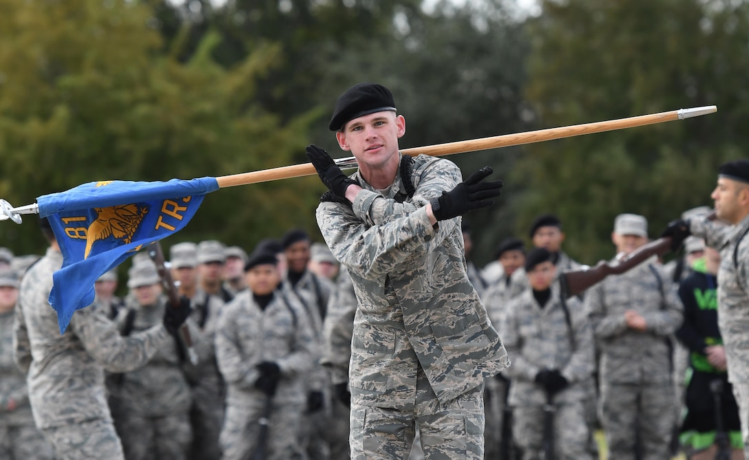 "U.S. Air Force Airman Kory King, 338th Training Squadron freestyle drill team member, performs during the 81st Training Group drill down on the Levitow Training Support Facility drill pad at Keesler Air Force Base, Mississippi, Nov. 2, 2018. The 338th TRS ""Dark Knights"" took first place in the freestyle competition. (U.S. Air Force photo by Kemberly Groue)"