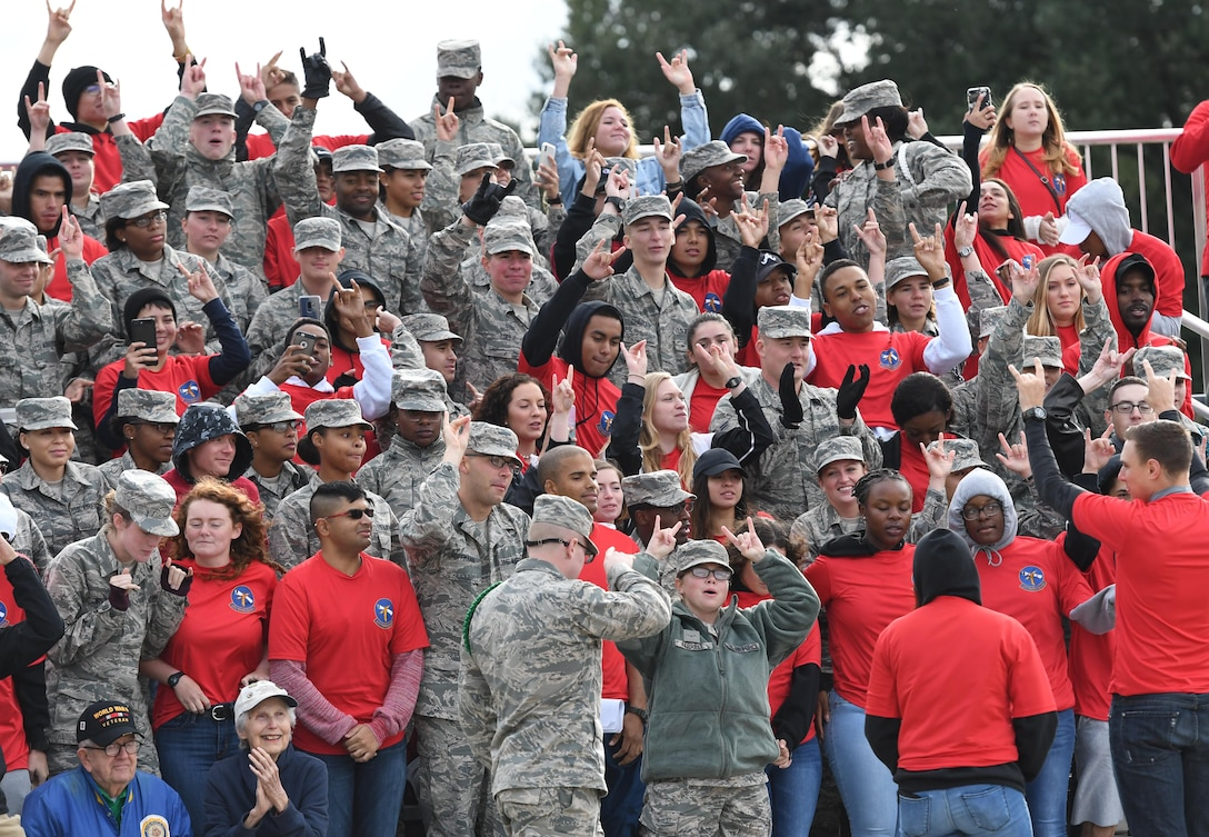 "Members of the 335th Training Squadron display four fingers after being named the overall winner for the fourth quarter during the 81st Training Group drill down on the Levitow Training Support Facility drill pad at Keesler Air Force Base, Mississippi, Nov. 2, 2018. The 335th TRS ""Bulls"" also took first place for the year. (U.S. Air Force photo by Kemberly Groue)"