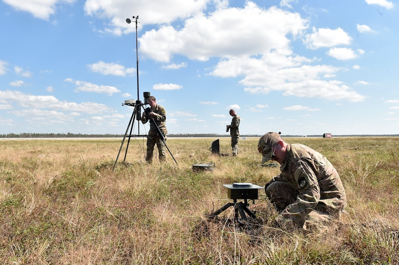 Weather personnel from the 821st Contingency Response Group and 2nd Combat Weather Systems Squadron set up a tactical meteorological observation system, Oct. 14, 2018, at Tyndall Air Force Base, Florida, in the aftermath of Hurricane Michael. The hurricane ripped through the base and the surrounding area causing severe damage. (U.S. Air Force photo by Tech. Sgt. Liliana Moreno)