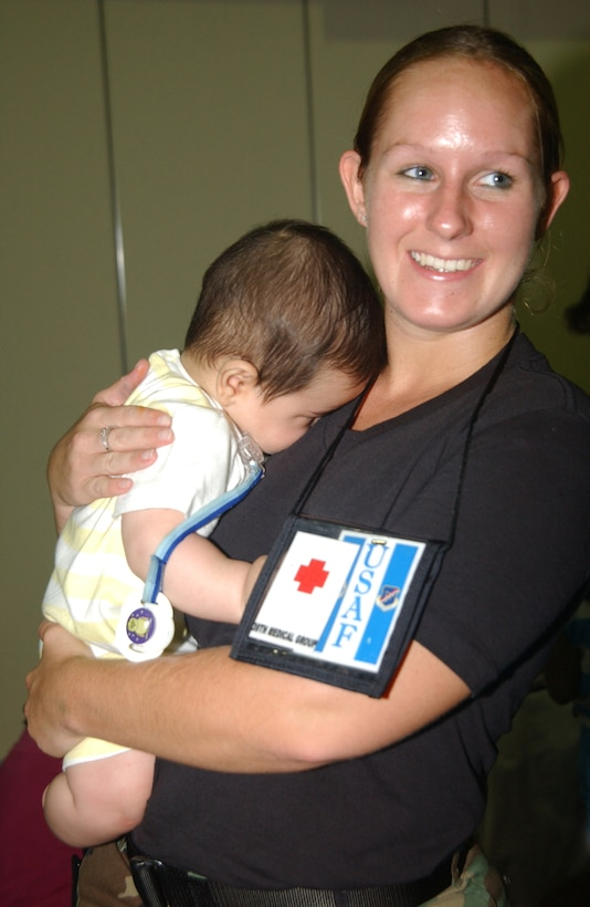 Incirlik Air Base Historical photo of Senior Airman Kylee Wright assists incoming families from Lebanon by holding a baby at incirlik Air Base, Turkey,2006.