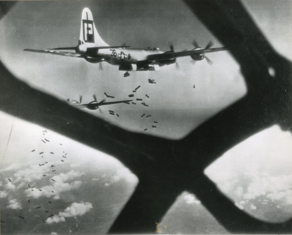 Incirlik Air Base Historical photo of B-29 Superfortress aircraft dropping munitions over Imperial Japan during WWII.