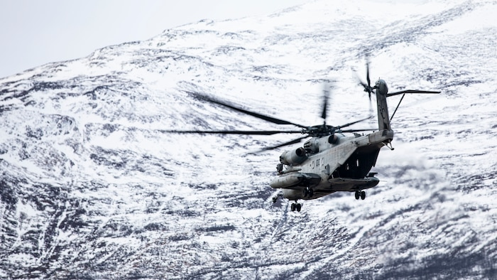 A U.S. Marine Corps CH-53E Super Stallion with Marine Heavy Helicopter Squadron 366 conducts flight operations during Trident Juncture 18 at Oppdal Air Base, Norway, Nov. 4, 2018. The exercise enhances the U.S. and NATO Allies' and partners' abilities to work together collectively to conduct military operations under challenging conditions. HMH-366 is with Marine Aircraft Group 29, 2nd Marine Aircraft Wing.