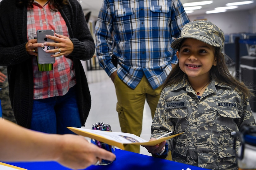 Cheyenne Arredondo, a youth center member, takes her deployment package, Nov. 3, 2018, at Joint Base Charleston, S.C.