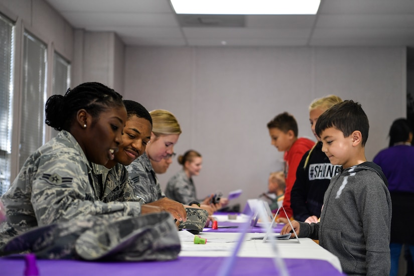 An Airman stamps a passport in a deployment line, Nov. 3, 2018, at Joint Base Charleston, S.C.