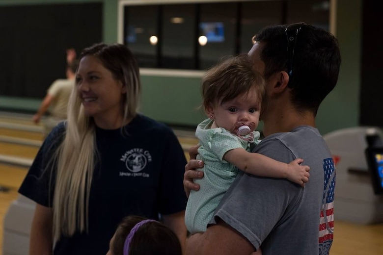1st Lt. Adam Kriete, 337th Air Control Squadron student, and his family, bowl after arriving to Patrick Air Force Base from Tyndall AFB, Fla. Oct. 18, 2018. Tyndall AFB was damaged by Hurricane Michael which displaced approximately 11,000 people, to include the Kriete family who travelled back to Tyndall during a five hour window to recover their belongings.
