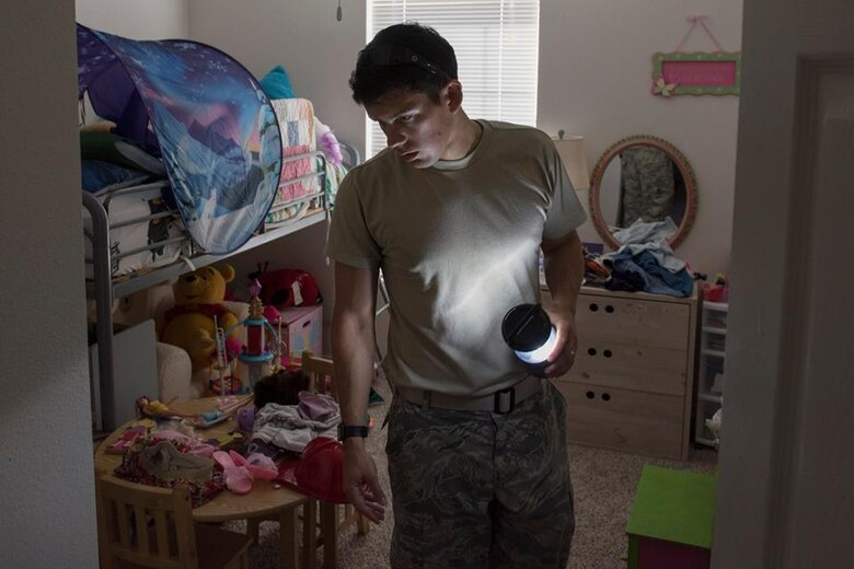 1st Lt. Adam Kriete, 337th Air Control Squadron student, searches for clothing items in his daughters room that was affected Hurricane Michael, at Tyndall Air Force Base, Oct. 19, 2018. Tyndall AFB was damaged by Hurricane Michael which displaced approximately 11,000 people, to include the Kriete family who travelled back to Tyndall during a five hour window to recover their belongings.
