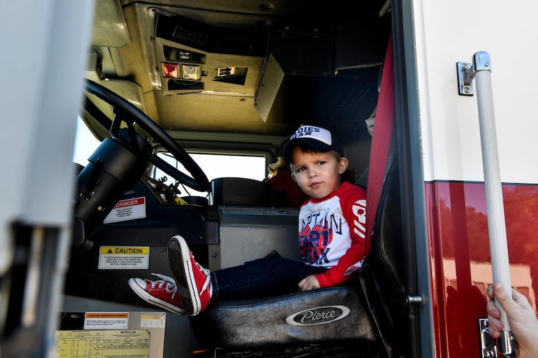 A child sits in a fire truck, Nov. 3, 2018, at Joint Base Charleston, S.C.