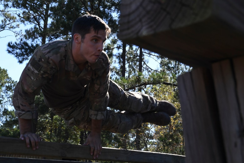 U.S. Air Force Staff Sgt. Benjamin Blake, a competitor from the 20th Air Support Operations Squadron, jumps over an obstacle during the Dragon Challenge 2018 at Fort Bragg, North Carolina Oct. 31, 2018. After the obstacle course, Dragon Challenge competitors took an Army knowledge test to see how well they understand the sister service they support. (U.S. Air Force photo by 1st Lt. Faith Brodkorb)