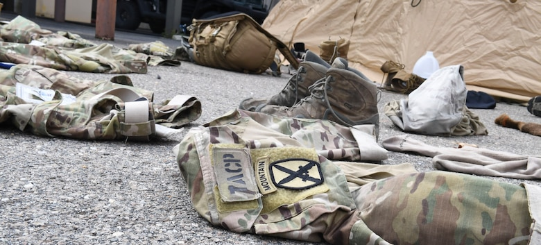 Dragon Challenge 2018 competitors leave their clothes out to dry in the sun after a 12-mile ruck march at Fort Bragg, North Carolina, Nov. 1, 2018. The competitors were so sweaty after the ruck march that they needed to let their clothes dry before the next event later that day. (U.S. Air Force photo by 1st Lt. Faith Brodkorb)