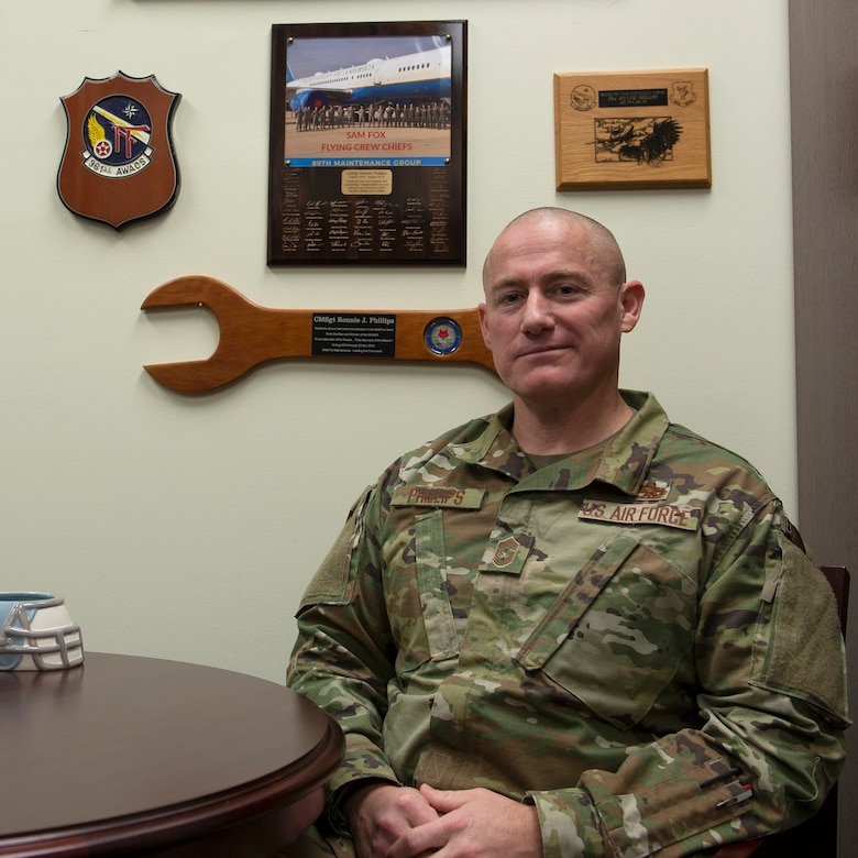 Chief Master Sergeant Ronnie Phillips, 437th Airlift Wing command chief, in his Wing Headquarters office at Joint Base Charleston, S.C. Phillips advises the wing commander, two groups, and seven squadron commanders on the utilization of over 1,600 enlisted members to ensure the wing's combat readiness.