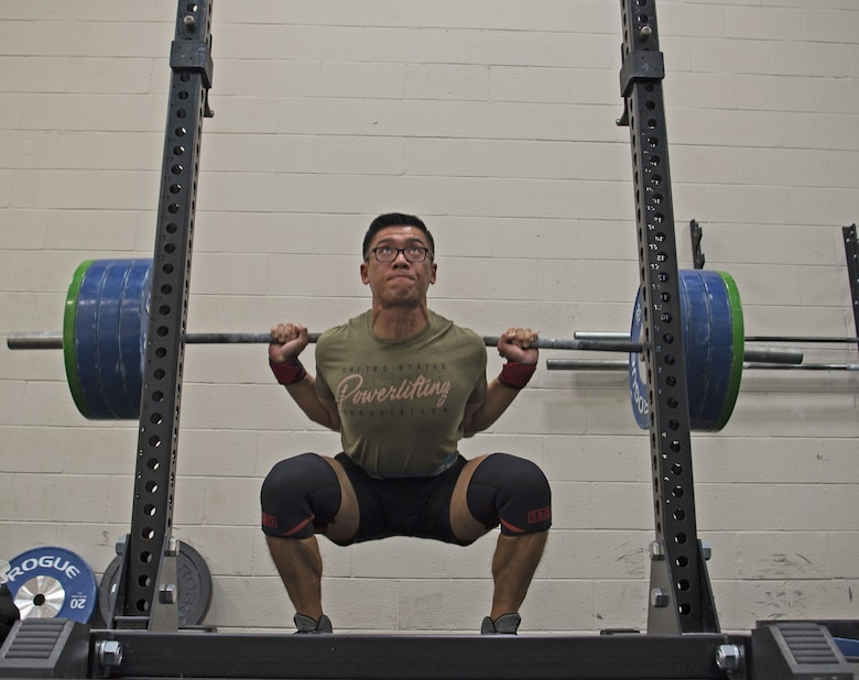 U.S. Air Force Staff Sgt. Allen Plata, 20th Equipment Maintenance Squadron stockpile management crew chief, squats to continue to keep proper form during off-season at Shaw Air Force Base, S.C., Nov. 1, 2018.