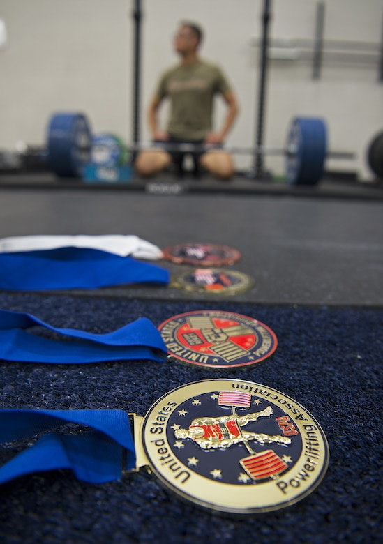 U.S. Air Force Staff Sgt. Allen Plata, 20th Equipment Maintenance Squadron stockpile management crew chief, displays his achievements at Shaw Air Force Base, S.C., Nov. 1, 2018.