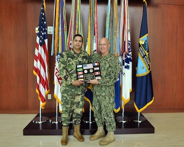 Paraguayan Army Col. Nery Torres Laconich, Partner Nation Liaison Officer assigned to U.S. Southern Command, presents plaque of appreciation to Navy Adm. Kurt Tidd.