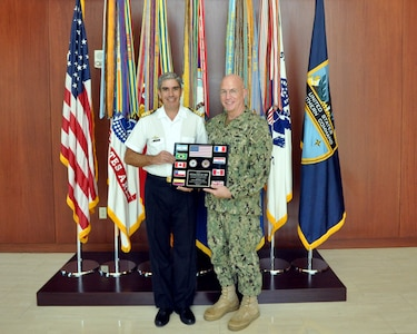 Argentine Navy Capt. Marcelo Fernandez, Partner Nation Liaison Officer (PNLO) assigned to U.S. Southern Command (SOUTHCOM) presents a plaque of appreciation to Adm. Kurt Tidd