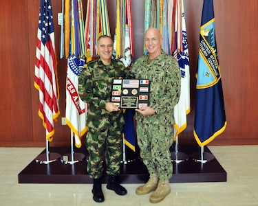 U.S. Southern Command (SOUTHCOM) Exercises and Coalition Director Colombian Army Brig. Gen. Juan Pablo Forero presents plaque of appreciation to Adm. Kurt Tidd