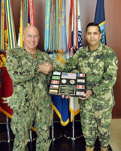 Paraguayan Army Col. Nery Torres Laconich, Partner Nation Liaison Officer (PNLO) assigned to U.S. Southern Command (SOUTHCOM) presents a plaque of appreciation to Adm. Kurt Tidd