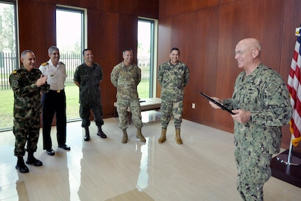Adm. Kurt Tidd, Commander, U.S. Southern Command (SOUTHCOM), addresses Partner Nation Liaison Officers (PNLOs) assigned to SOUTHCOM after receiving a plaque of appreciation for his leadership and tireless efforts.