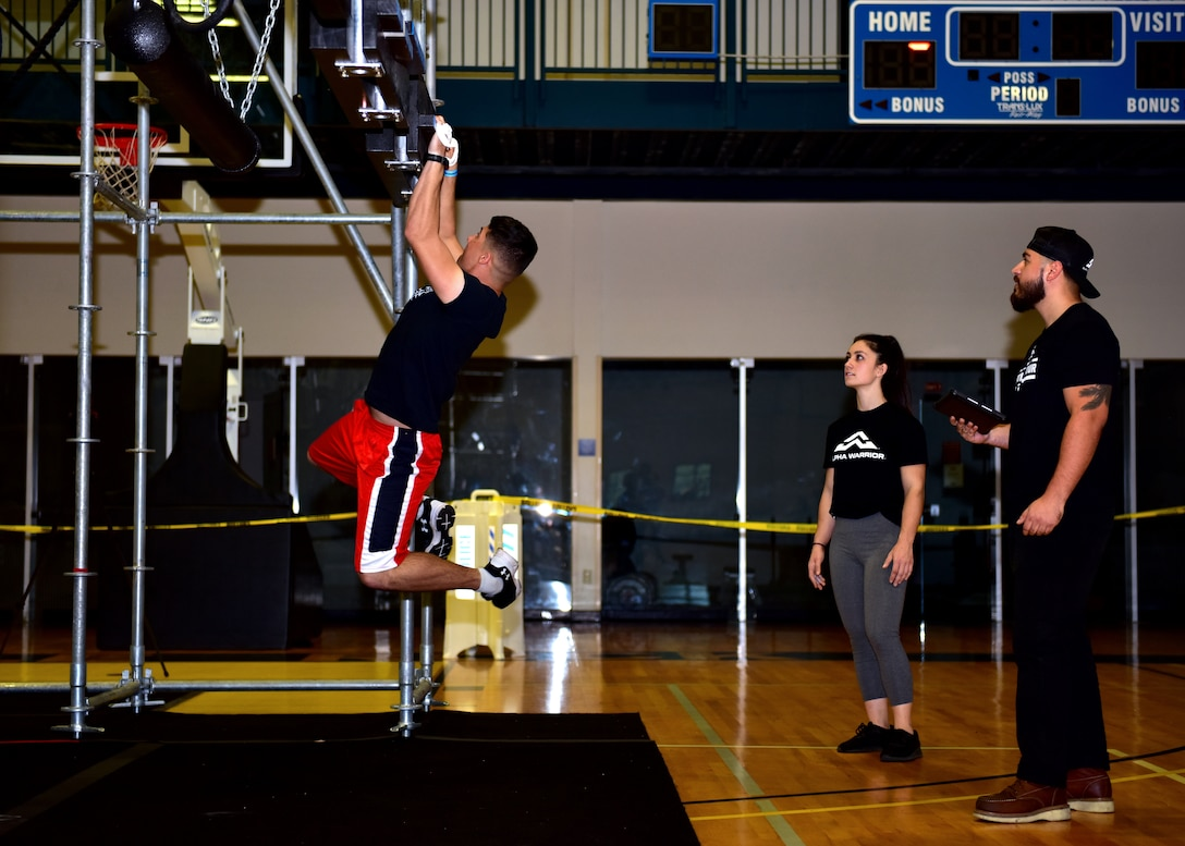 Individuals participate in a competition obstacle course.