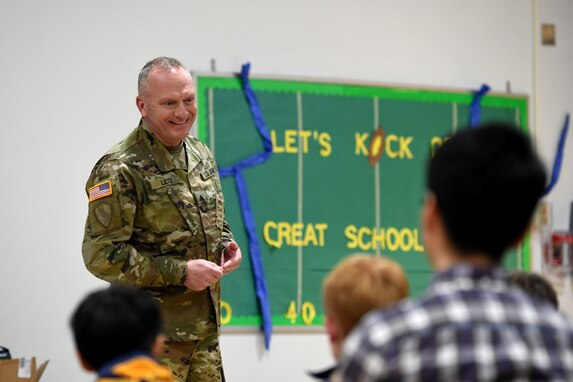 Sgt. David Lietz, public affairs sergeant with the 85th Support Command, speaks with students about his service during the Lyon Elementary School Veteran's Day observance in Glenview, Illinois, November 5, 2018.