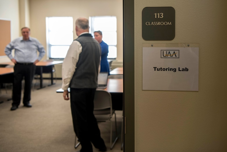 Education service staff prepare for a ribbon-cutting ceremony at the Joint Base Elmendorf-Richardson Education Center Nov. 2, 2018. The ceremony marks the opening of the academic tutoring room sponsored by the University of Alaska Anchorage (UAA). This room is open to all active-duty personnel, dependents and veterans, no matter which school they attend.