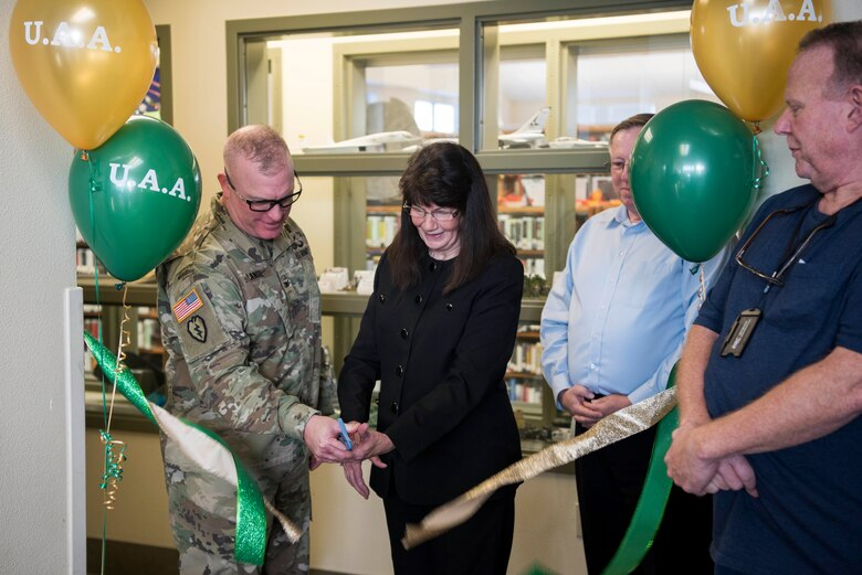 U.S. Army Col. Adam Lange, 673d Air Base Wing vice commander, and Renee Carter-Chapman, University of Alaska Anchorage (UAA) senior vice provost, cut the ribbon during a ceremony at the Joint Base Elmendorf-Richardson Education Center Nov. 2, 2018. The ceremony marks the opening of the academic tutoring room sponsored by the UAA. This room is open to all active-duty personnel, dependents and veterans, no matter which school they attend.