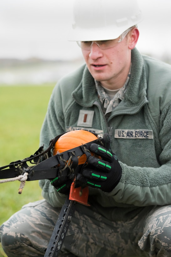 2nd Lt. Joshua Lightner, Air Force Life Cycle Management Center's F-15 Engineering Branch, loads a pumpkin into a trebuchet-style catapult Nov. 2 in preparation for the 14th annual Wright-Patterson Air Force Base, Ohio, pumpkin chuck.