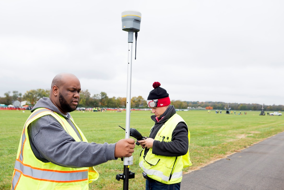 Staff members use GPS surveying equipment to measure the distance a pumpkin was chucked during the 14th annual Wright-Patterson Air Force Base, Ohio, pumpkin chuck Nov. 2.