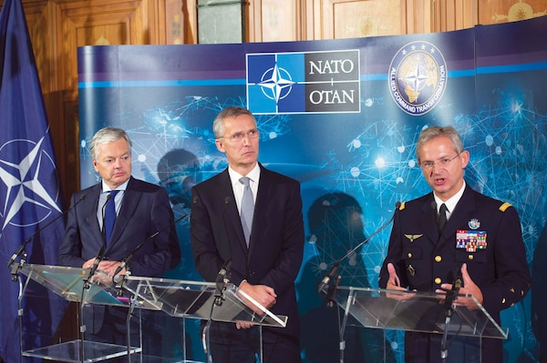 Former Supreme Allied Commander Transformation General Denis Mercier (right) speaks at a NATO-Industry Forum in 2016.