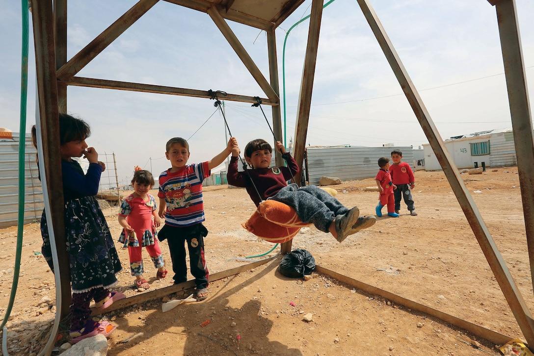 United Nations Photo: Zaatari Refugee Camp, Jordan. From < https://www.flickr.com/photos/un_photo/33628939391/in/photolist-2a64bte-28GYMmp-VCy7hg-VQ2Vbv-VQ2Vai-VCy7dP-VQ2V8K-VCy7fH-VeMotq-SR6t3d-TeF74R-PGYtjG-HKHnQi-JCTiNC-Fw6LcE-G2rSum-FwhcDR-Gip8jU-GkHFA8-GrymiX-FR748F-FGW5tG-EVRf8x-FGW5iS-Dt1Upf-pKPPMx-ptnYrC-dWGdNT-8B4nDo-6R1KQH-6R5Nxf-6R5Nwy-6R1KNT-6R1KPp-6R1KNr-6R1KLM-6R1KLr-6R1KKp-6R5NrE-6R5NqE-6R1KK4-72kEss-6pmvEr-63srmZ>. Licensed under Creative Commons Attribution 2.0 Generic License. Photo unaltered.