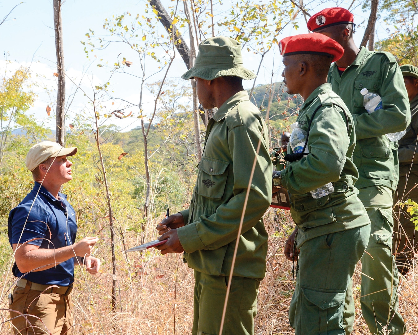 In July, U.S. soldier assigned to the Combined Joint Task Force—Horn of Africa provides guidance for Tanzania Wildlife Management Authority game wardens during a ground surveillance exercise in Tanzania