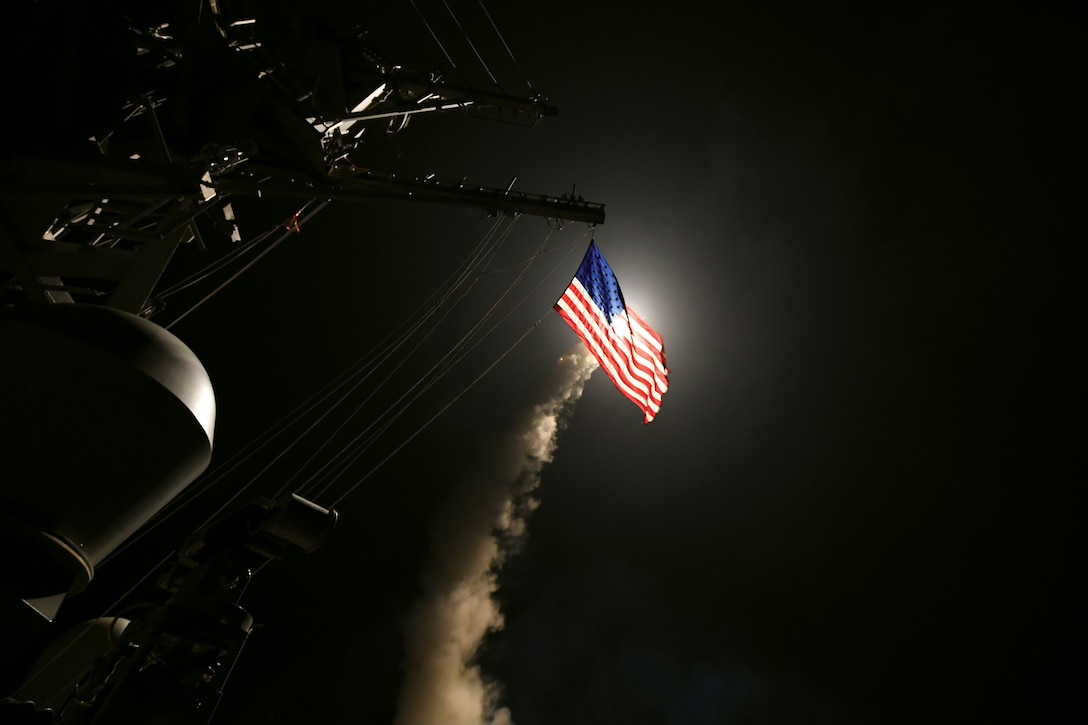 The guided-missile destroyer USS Porter conducts strike operations against a target in 2017. (U.S. Navy/Ford Williams)