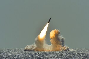 In March, an unarmed Trident II D5 missile launches from the USS Nebraska in the Pacific Ocean. The successful test launch certified the readiness of the ballistic submarine missile crew and the operational performance of the submarine's strategic weapons system. (U.S. Navy/ Ronald Gutridge)