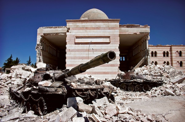 Two destroyed tanks in front of a mosque in Azaz, Syria. A battle between the Free Syrian Army (FSA) and the Syrian Arab Army (SAA) was fought from March to July in 2012 for control over the city of Azaz, north of Aleppo, during the Syrian civil war. (Christian Triebert)