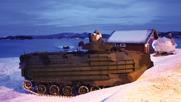 A Marine amphibious assault vehicle hits the beach through the Namsos fjord in March 2016 to support NATO allies and partners during the final training of Exercise Cold Response 16. The cold-weather training integrated air, land, and sea capabilities of 13 nations and more than 15,000 troops to improve capacity to coordinate and respond to threats as a team.
