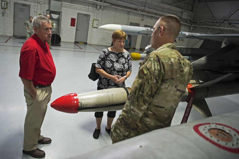 Retired Chief Master Sgt. Kevin Foulois, great-nephew of the late retired Maj. Gen. Benjamin Foulois, speaks with Chief Master Sgt. Jon Young, 20th Maintenance Group wing weapons manager, at Shaw Air Force Base, S.C., Nov. 2, 2018.