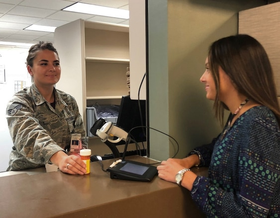 SrA Yana Ingram, a Pharmacy Technician with the 97th Medical Group, fills a prescription at the Altus Air Force Base pharmacy in Oklahoma. Ingram found her way to the US Air Force from a Ukrainian orphanage.