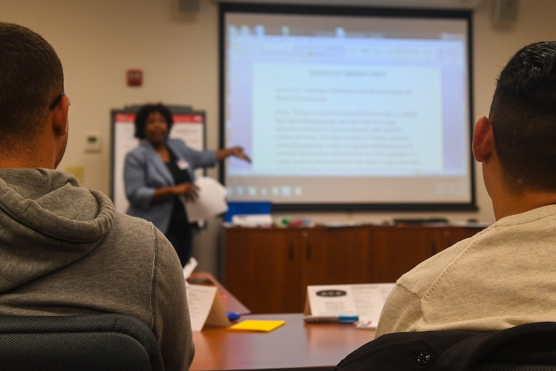 Two delegates participate in the Army Family Action Plan discussions at Joint Base Langley-Eustis, Virginia, Oct. 31, 2018. The AFAP provides community members, including service members, spouses, retirees and civilian employees, the opportunity to discuss issues affecting the installation and present them to the commander. (U.S. Air Force photo by Senior Airman Derek Seifert)