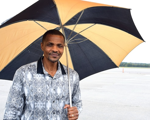Lloyd Johnson, 94th Operations Group meteorologist technician, poses for a photo on the flightline at Dobbins Air Reserve Base, Georgia, Nov. 2, 2018. Brig. Gen. Richard Kemble, 94th Airlift Wing commander, presented Johnson with a letter from AFRC announcing Johnson as this year's weather civilian of the year. (U.S. Air Force photo/Staff Sgt. Andrew Park)